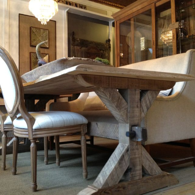 Reclaimed barnwood table with trestle base. Custom made with a live edge for that rustic but elegant style.