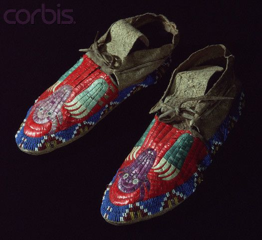 Plains moccasins adorned with quillwork and beadwork Circa 1895. Moccasins with bear claw and buffalo head motif. Plains Indian Museum, Buffalo Bill Historical Center, Cody, Wyoming, USA.