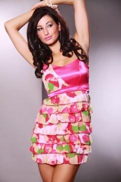 Un vestido de fiesta la diversión con un corte asimétrico, la parte superior de satén, gasa polkadot impresos detalles, una falda con gradas, y un cierre de cremallera oculta en el lateral. 100% Poliéster