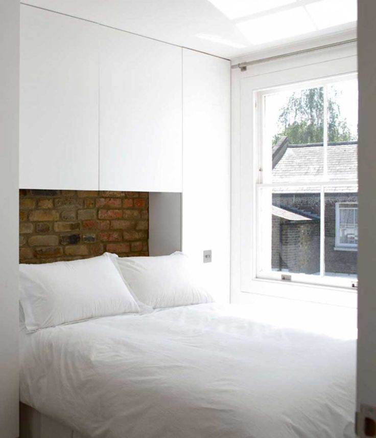How to creat storage in a small double bedroom. Building wardrobes around the bed but using a neutral colour scheme