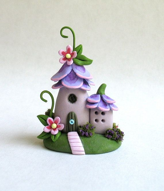 This miniature whimsical, fairy blossom house is a one of a kind original design and creation by artist C. Rohal. It is completely hand made from