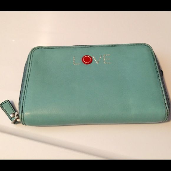 "Turquoise ""LOVE"" Fossil Waller Turquoise ""LOVE"" Fossil Wallet. Great Condition. 4 in x 6.5 in. Make and offer 😺 Fossil Bags Wallets"