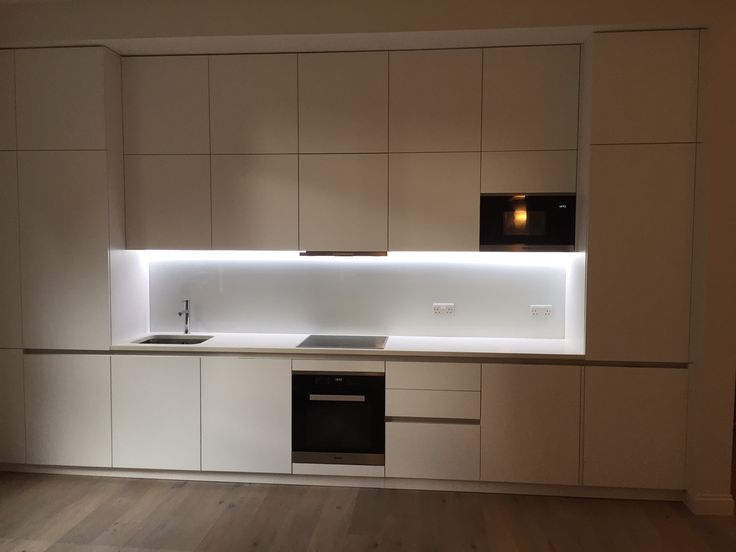 Matt White handless kitchen completed Vicotria Sw1