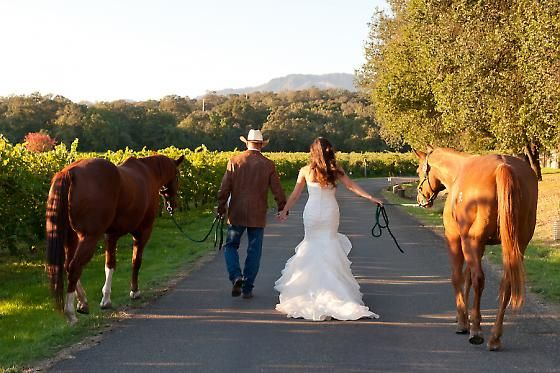 Breanne & Cole's cowboy wedding. Photography by Tia & Claire Studio.  A cowboy, a cowgirl and their horses ride off into the sunset.