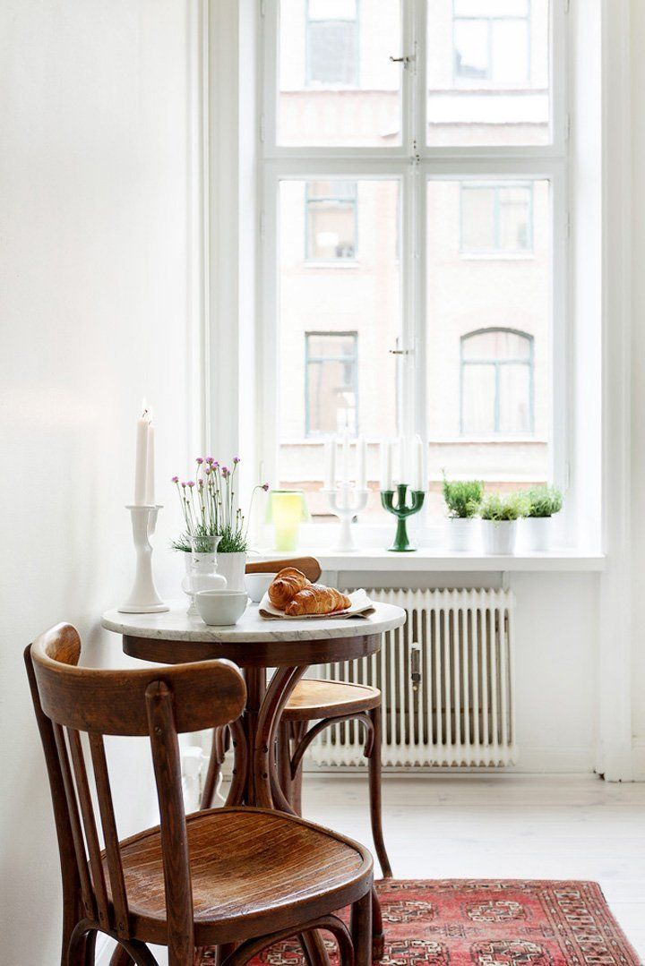 Bistro tables are one of the best ways to add a dining area to a small home or apartment. Plus, starting your day at a cozy table with a fresh French press or an individual pot of tea is our idea of the perfect morning.   	   Here are 12 bistro tables that we would like to have as part of our homes.
