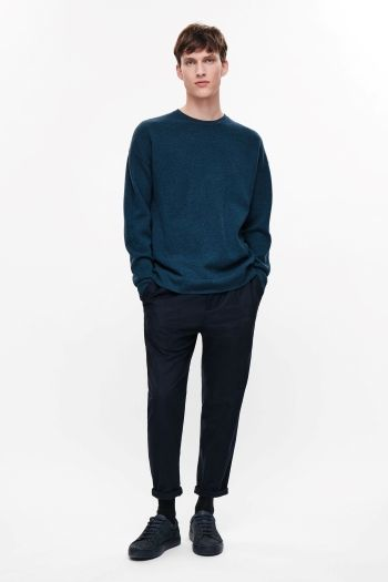 COS image 1 of Relaxed lambswool jumper in Petrol Blue