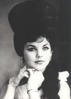 Young Priscilla Presley in a White Blouse with a Beehive.  This was how Elvis liked her to dress.
