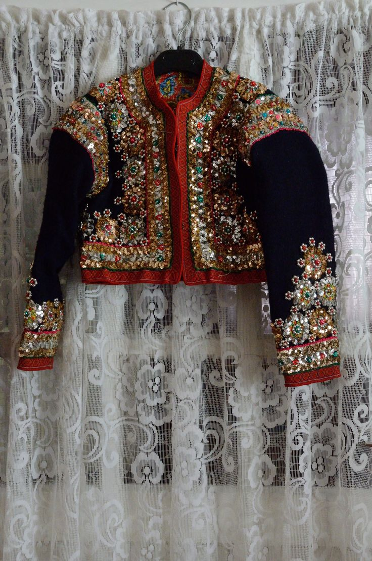 Gorgeous short coat adorned with beads, sequins and embroidery.