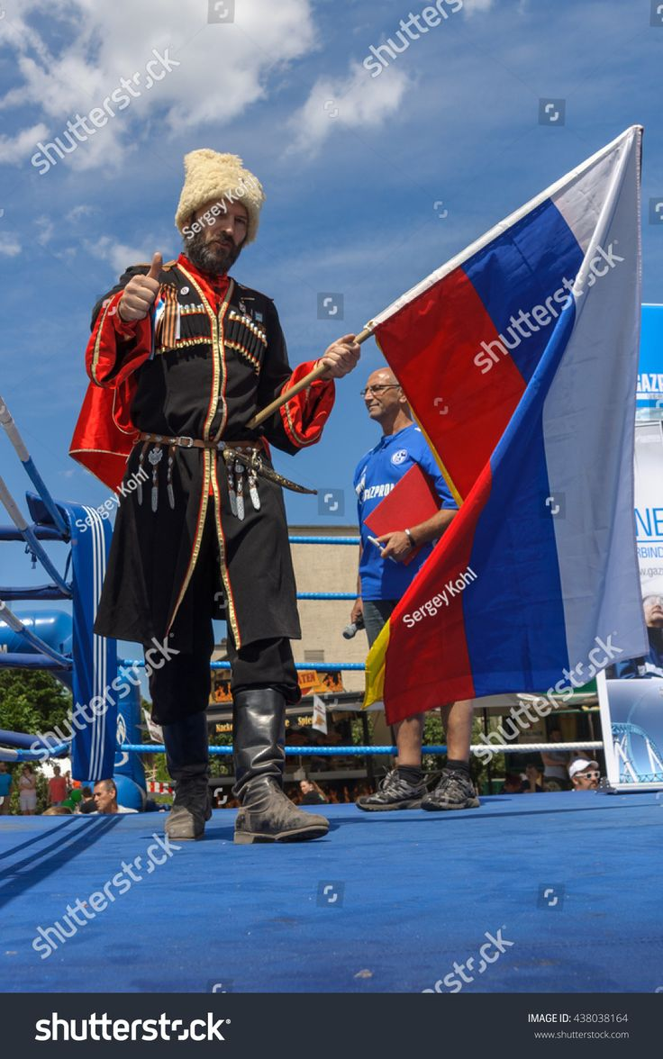 BERLIN - JUNE 11, 2016: Russian Cossack with the Russian flag. German-Russian festival devoted to the Independence Day of Russia. District Karlshorst, East Berlin.