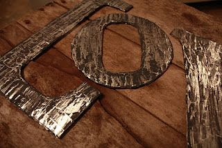 distressed metal - actually cardboard, aluminum foil and paint! who knew?