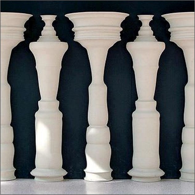 optical illusion. White decoration thingies and people.
