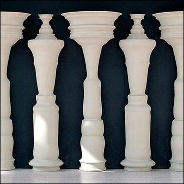 optical illusion. White decoration thingies and people.