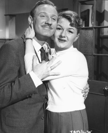 Child Psychologist Alistair Grigg (Leslie Phillips) falls for Maudlin Street School's games mistress Sarah Allcock (Joan Sims). Carry On Teacher (1959).