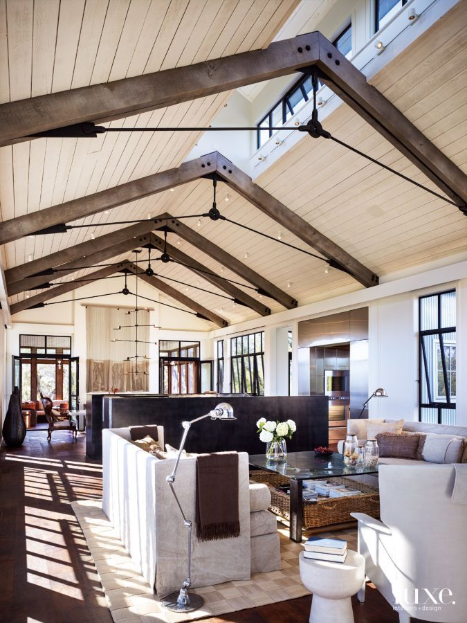 Living Room with High Ceilings and Beams