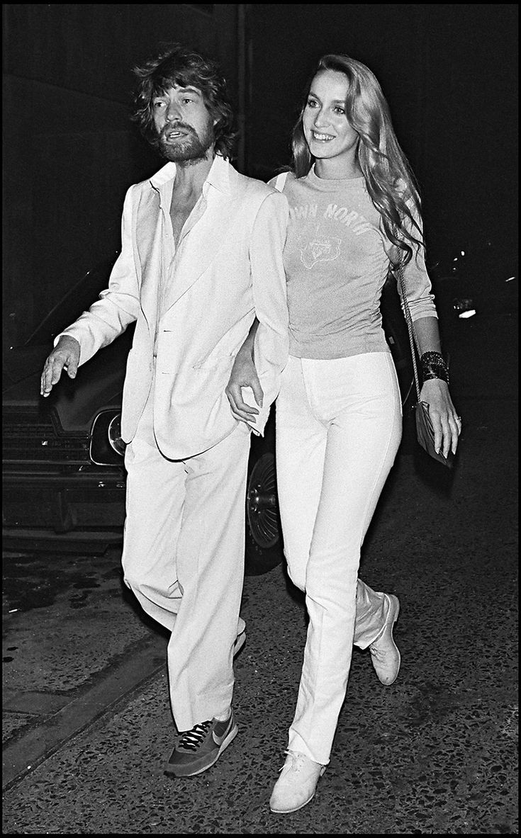 Jerry Hall & Mick Jagger.  her legs are longer. she wins.