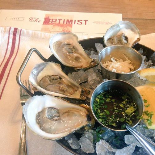 East Coast and Raspberry Point Oysters from PEI at The Optimist in Atlanta, Georgia. Photo by @EatingwErica