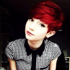 Red hair debating on a cut