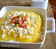Mamaliga - Polenta dish with sour cream and feta cheese. Sooo good for breakfast or lunch