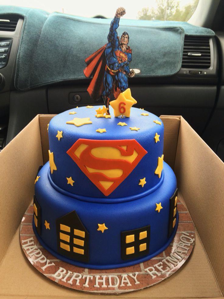 Superman birthday cake with fondant decorations.
