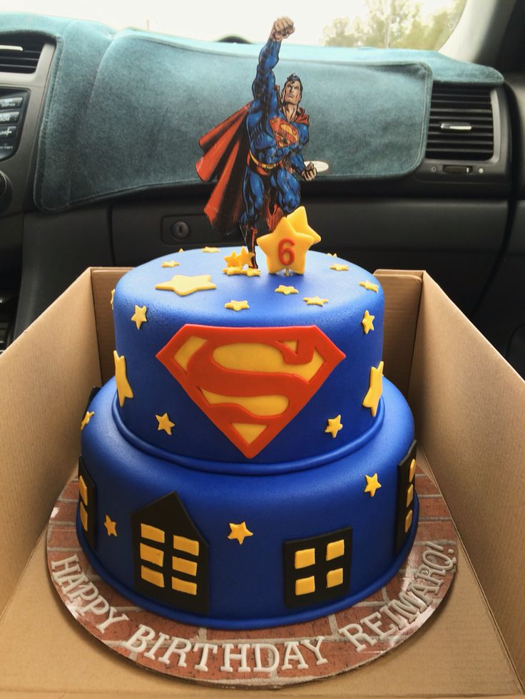 Superman birthday cake with fondant decorations.