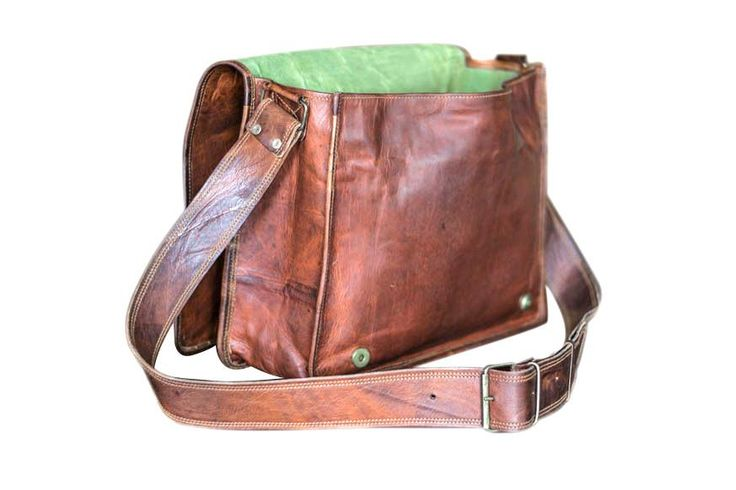 FREE SHIPPING (check shipping tab for more information) Made of 100% genuine goat leather Adjustable shoulder strap Inner canvas lining Handmade by highly expe