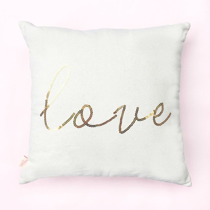 """Love Gold Sequins Pillow Cover. Cozy up with a good book or movie with your new SWD pillow! Perfect to display on our couch or in any bedroom, our classic pillows are soft, comfy, and made with a natural cotton canvas material. This cover can be paired with any 16x16"""" pillow insert! ♥ 16x16"""" Cotton Canvas Off-White Pillow Cover Only ♥ Pillow Reads: Love in Gold Sequins ♥ The O and the V in this style are disconnected ♥ Design On One Side ♥ Includes Pillow Cover Only ♥ Pillow Cover Can Be..."""