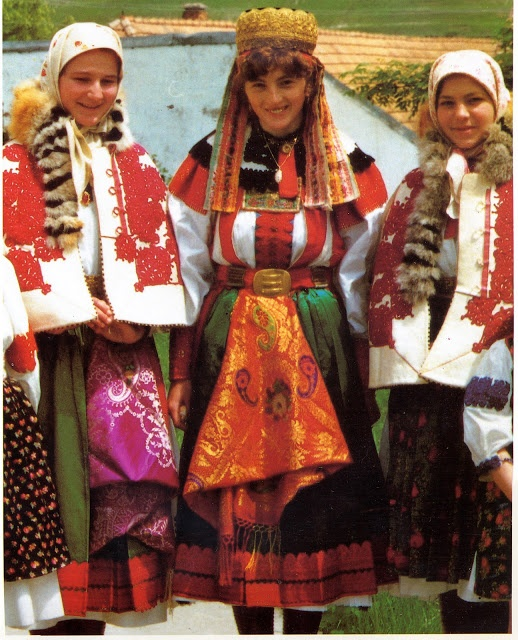 Hungarian traditional costume: from the area of Torocko in Transylvania. I think the lady in the middle might be a bride.