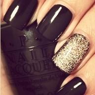 deep purple nails + gold glitter accent.