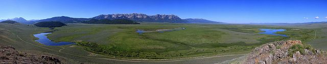 "panorama of the northeast area of the Red Rock Lakes National Wildlife Refuge. In the foreground is Picnic Creek, and on the left is Culver Pond, fed by Picnic Springs. On the right is Widgeon Pond. The Centennial Mountains (Mount Taylor and Sheep Mountain) border the image on the far south.  Credit: James ""Newt"" Perdue / USFWS"