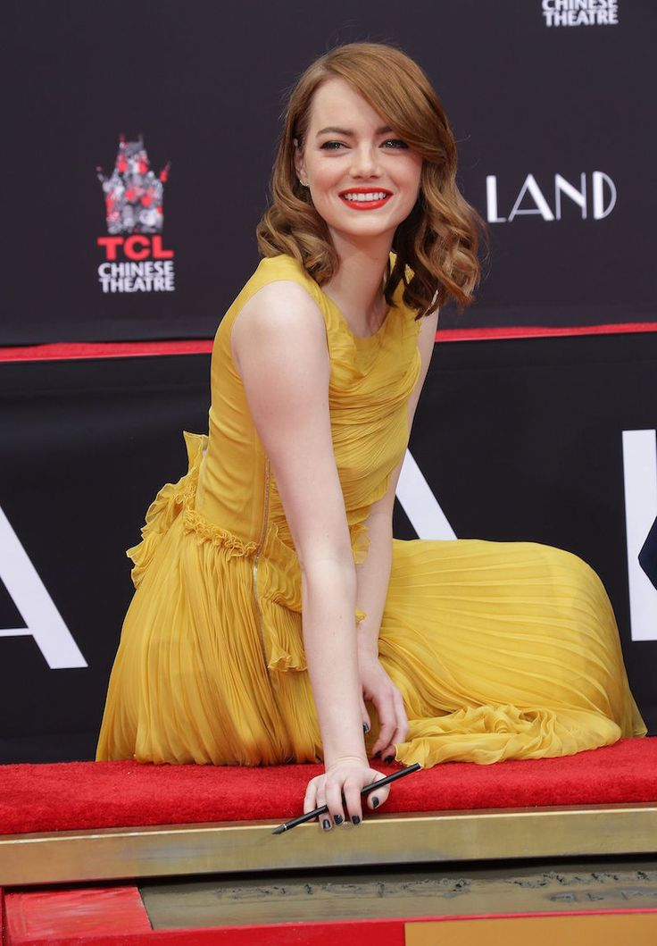 Emma Stone attending a handprint ceremony for her new movie La La Land at Hollywood's TCL Chinese Theatre.