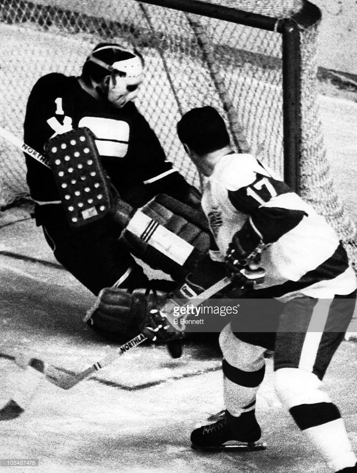 Goalie Charlie Hodge #1 of the Vancouver Canucks makes the save on a shot that was deflected by Wayne Connelly #17 of the Detroit Red Wings during their game on November 26, 1970 at the Detroit Olympia Arena in Detroit, Michigan.