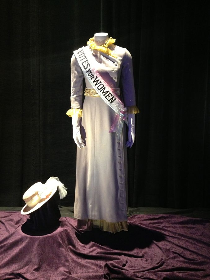 Mrs. Bank's signature periwinkle and yellow dress (with banner) will make you want to break out into song.