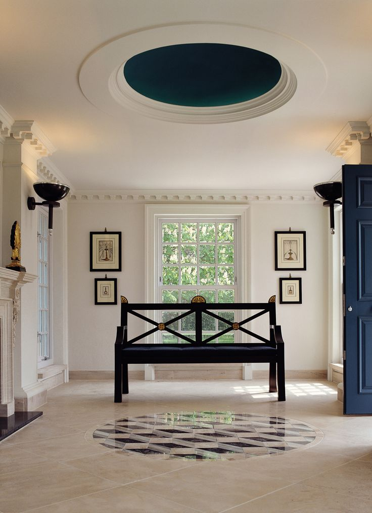 Inlaid geometric marble floor reflecting the dome ceiling.  Thomas Hope-inspired bench.  Carved limestone fireplace, after the original by Sir Williams Chambers.  Gold-leaf Regency acanthus leaves sitting on fireplace.