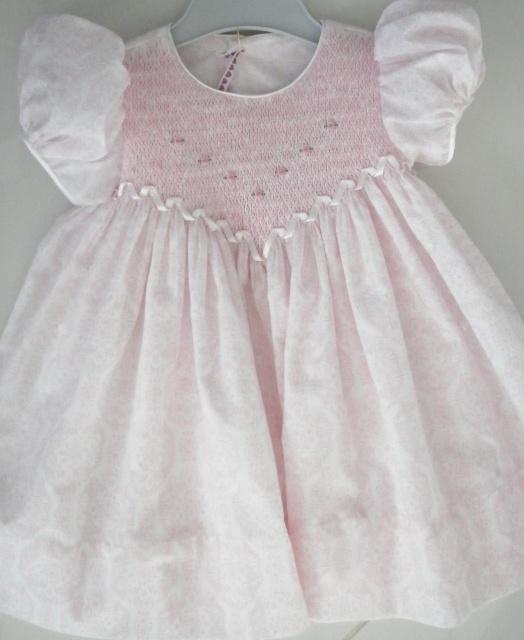 Stunning hand smocked babies dress.
