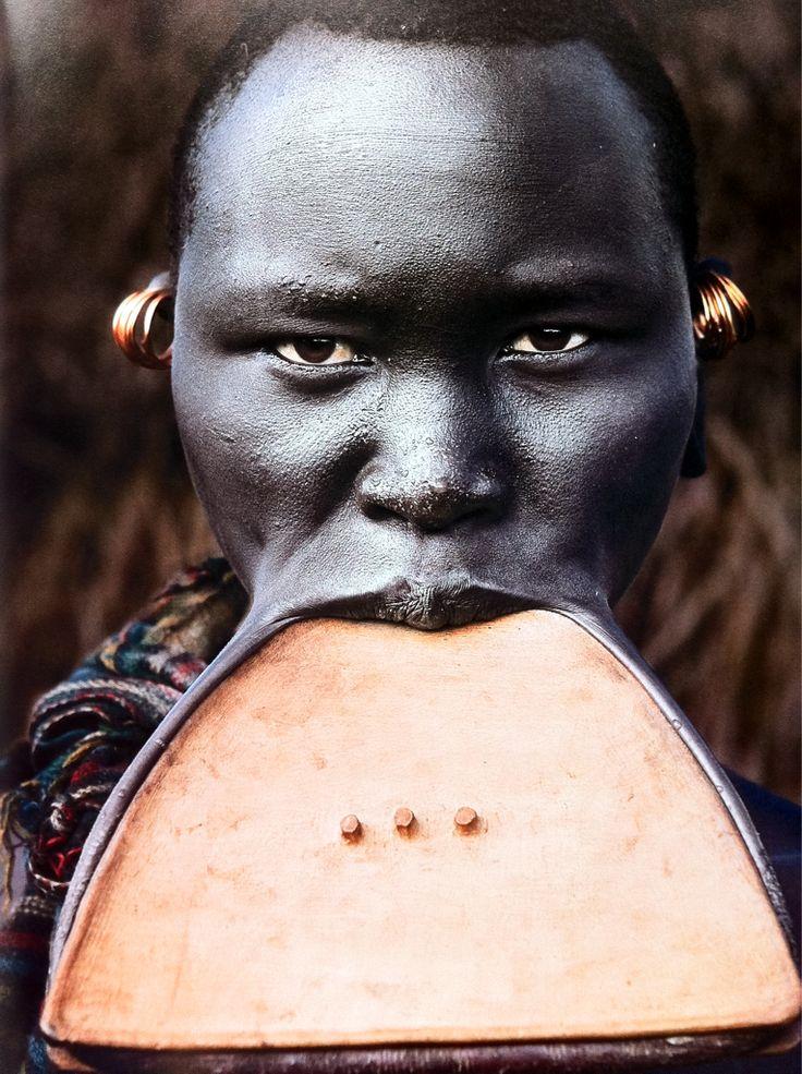 Suri tribeswoman with wooden lip plate, Omo Delta, Ethiopia - © Steve Bloom.
