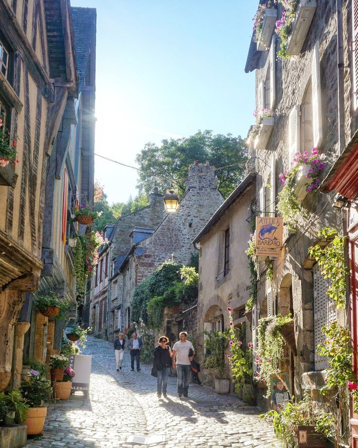 Postcards from Dinan, a medieval town in Brittany, France http://www.traveling-cats.com: