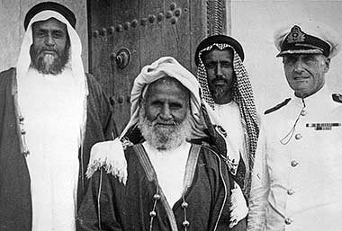 Sheikh Abdullah bin Jassim al Thani, son of the man commonly considered to be the founder of the modern State of Qatar, Sheikh Jassim bin Muhammad al Thani. On his right is his son, Sheikh Ali bin Abdullah al Thani, who became Ruler following his father's abdication in 1948 and, on Sheikh Ali's right is his brother, Sheikh Hamad bin Abdullah, grandfather of the present Ruler, Sheikh Hamad bin Khalifa al Thani.