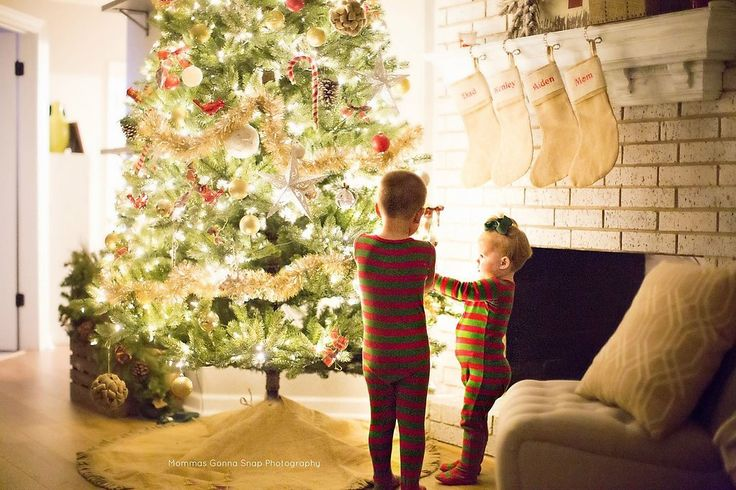 Between the matching pajamas and the intimate Christmas tree glow, this innocent moment is destined to be f...