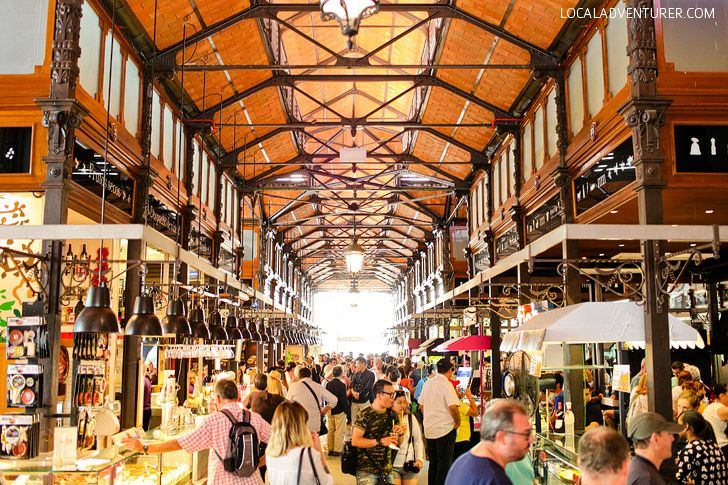 Enter Foodie Heaven at Mercado de San Miguel Madrid. There is tons of food so you can try a little bit of everything. Sample fresh fruit, peppers, tapas, sangria, pizza, coffee, frozen yogurt, meats and sausages, fish & caviar, and more. Some stalls offer a free glass of wine when you buy something.