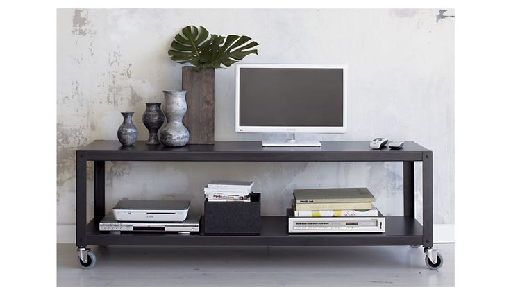 Shop go-cart carbon rolling tv stand/coffee table. Nifty metal multitasker powdercoated carbon grey rolls into office, front of sofa, under flatscreen on four commercial wheels; two wheels lock.
