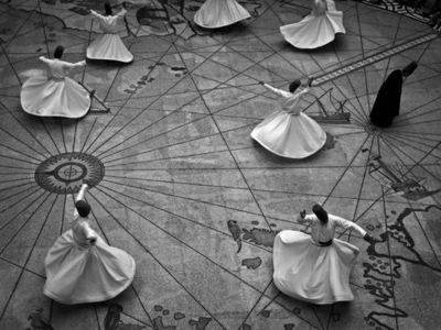 """""""Whirling dervishes perform the ritual dance of the Sufi sect in a showroom in Ankara, Turkey. Practitioners believe the act of repeatedly spinning allows them to forget their earthly body and move closer to God."""" Photograph bySukri Celil Advan, National Geographic"""