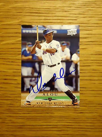 Moises Alou: (2007-2008 New York Mets) 2008 Upper Deck baseball card signed in blue sharpie. (From my All-Time Mets Roster collection.)