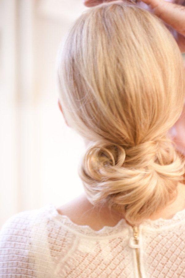 a sleek, vintage-inspired ponytail.