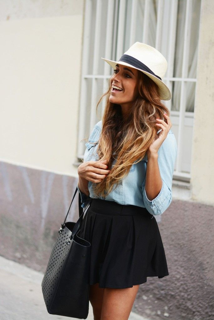 Pair a light blue denim shirt with a black pleated skirt for a Sunday lunch with friends.   Shop this look on Lookastic: https://lookastic.com/women/looks/light-blue-denim-shirt-black-skater-skirt-black-tote-bag-white-and-black-hat/10459   — White and Black Straw Hat  — Light Blue Denim Shirt  — Black Skater Skirt  — Black Leather Tote Bag