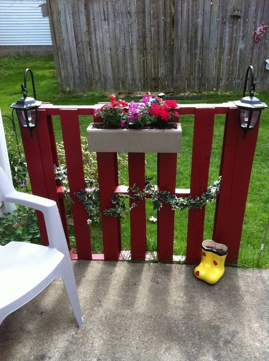 wood pallet projects | Wood Pallets / Pallet Project 3.  I'm thinking behind the raised beds with hanging flower beds for strawberries.