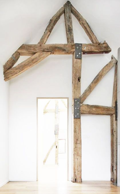The juxtaposition of beautiful old wooden beams with hardware visible with the crisp modern feel of white walls is extraordinary.