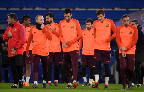 Barcelona players warm up during an FC Barcelona Training Session ahead of their Champions League last 16 match against Chelsea at Stamford Bridge on February 19, 2018 in London, England.