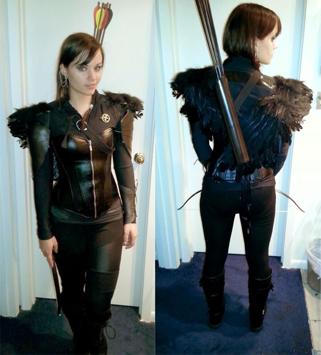 I am the Mockingjay! this is my Halloween costume this year :) I made the wings and the armor and props, trying to base it on the promotional images as much as possible.