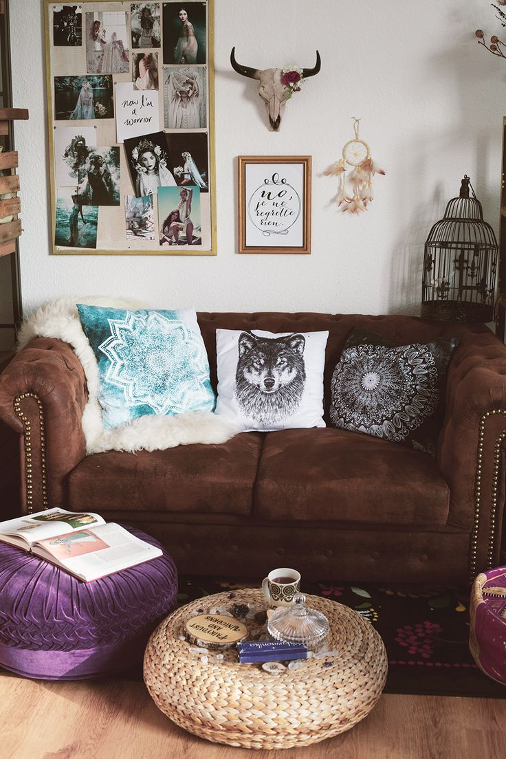 Boho living room with leather couch and pretty pillows