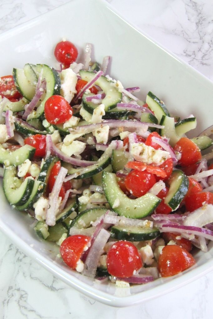 This simple, 5 ingredient Greek salad is the perfect addition to all of your summer celebrations!